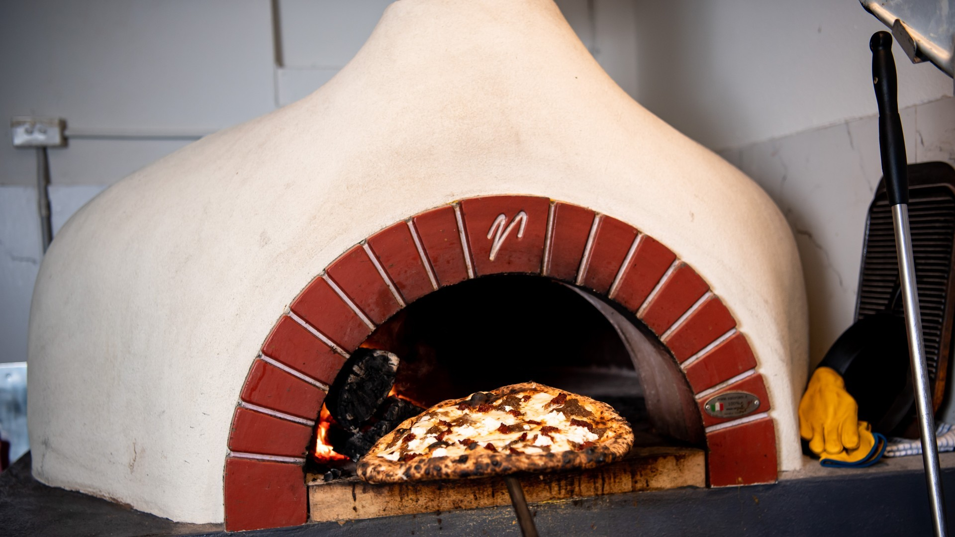 Pizza in a clay pizza oven