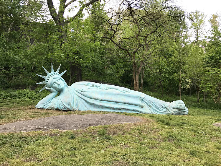 Get a picture of a reclining Statue of Liberty