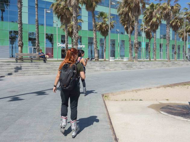 BARCELONA, SPAIN. May 15-2019: Girls skating along the Barceloneta promenade.