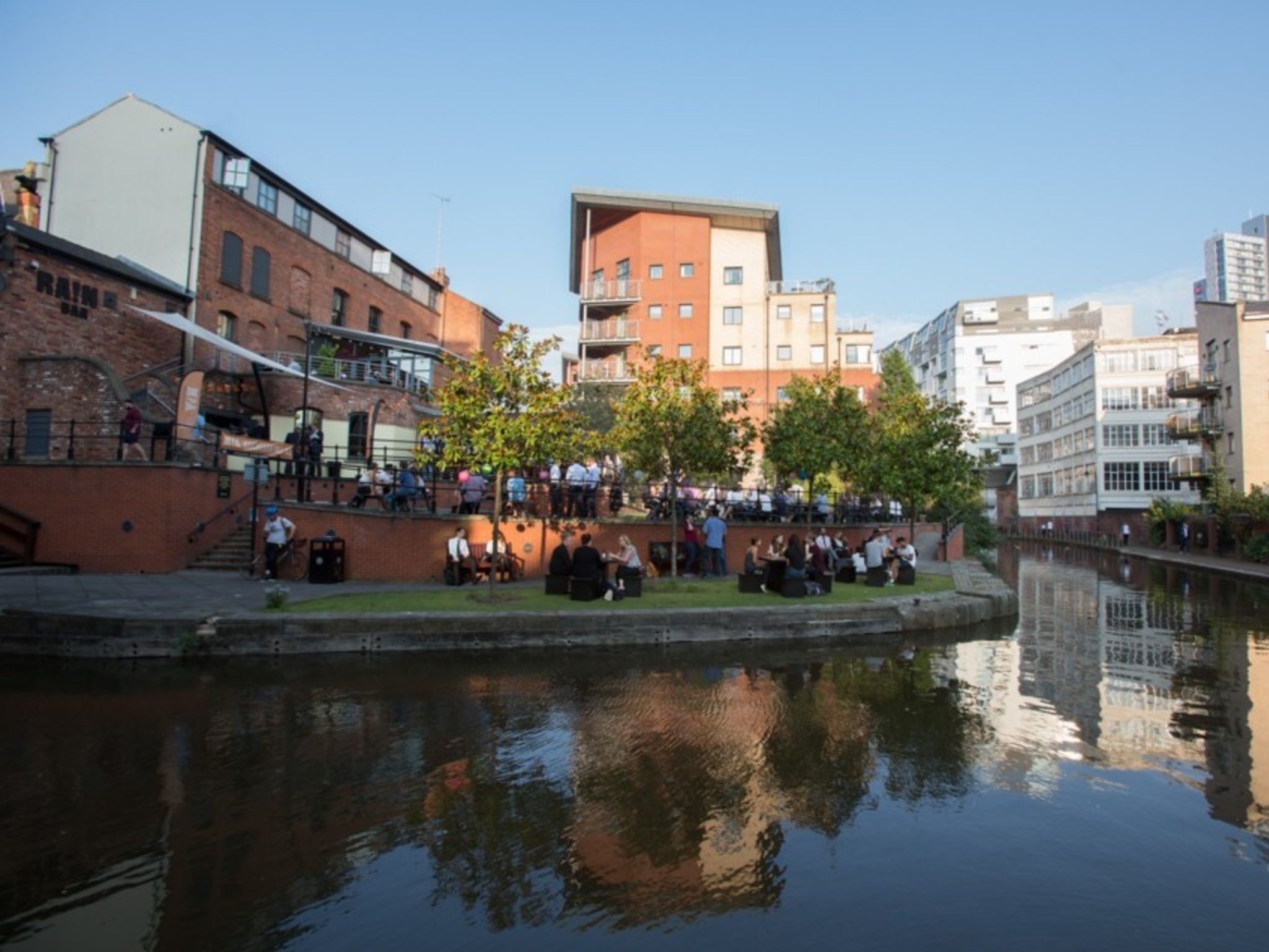 People drinking next to the canalside