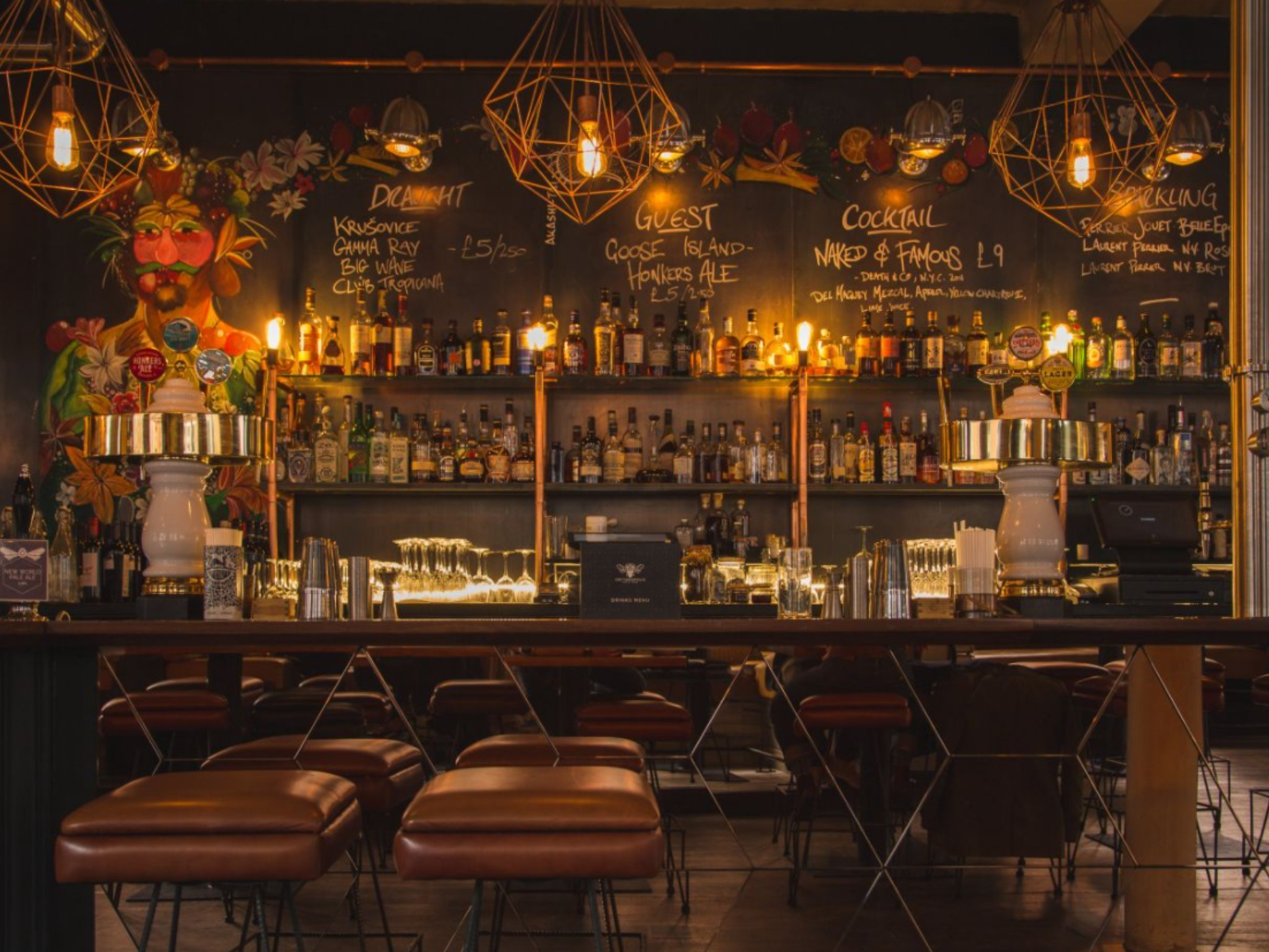 A dimly lit bar with a selection of bottles