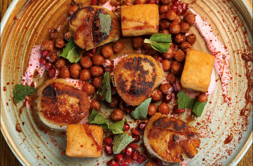 Scallops and vegetables on a plate, The Ravenous Pig