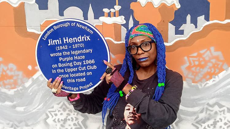 Neandra Etienne with Hendrix's plaque