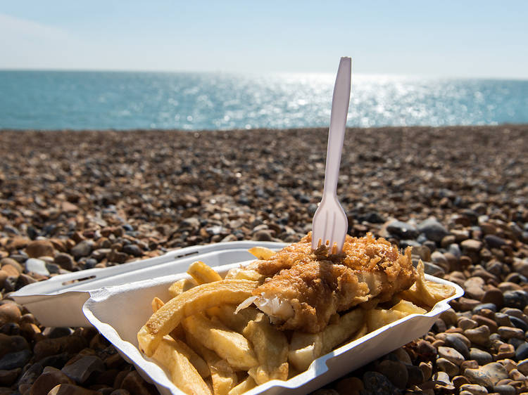 Eat fish and chips on the pebbles in Brighton