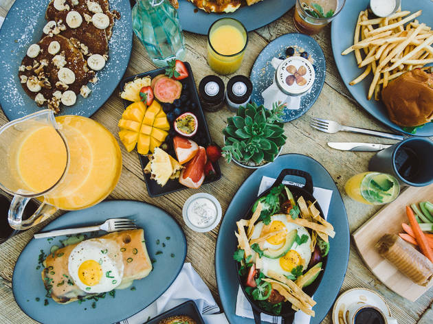Table filled with plates of food for brunch