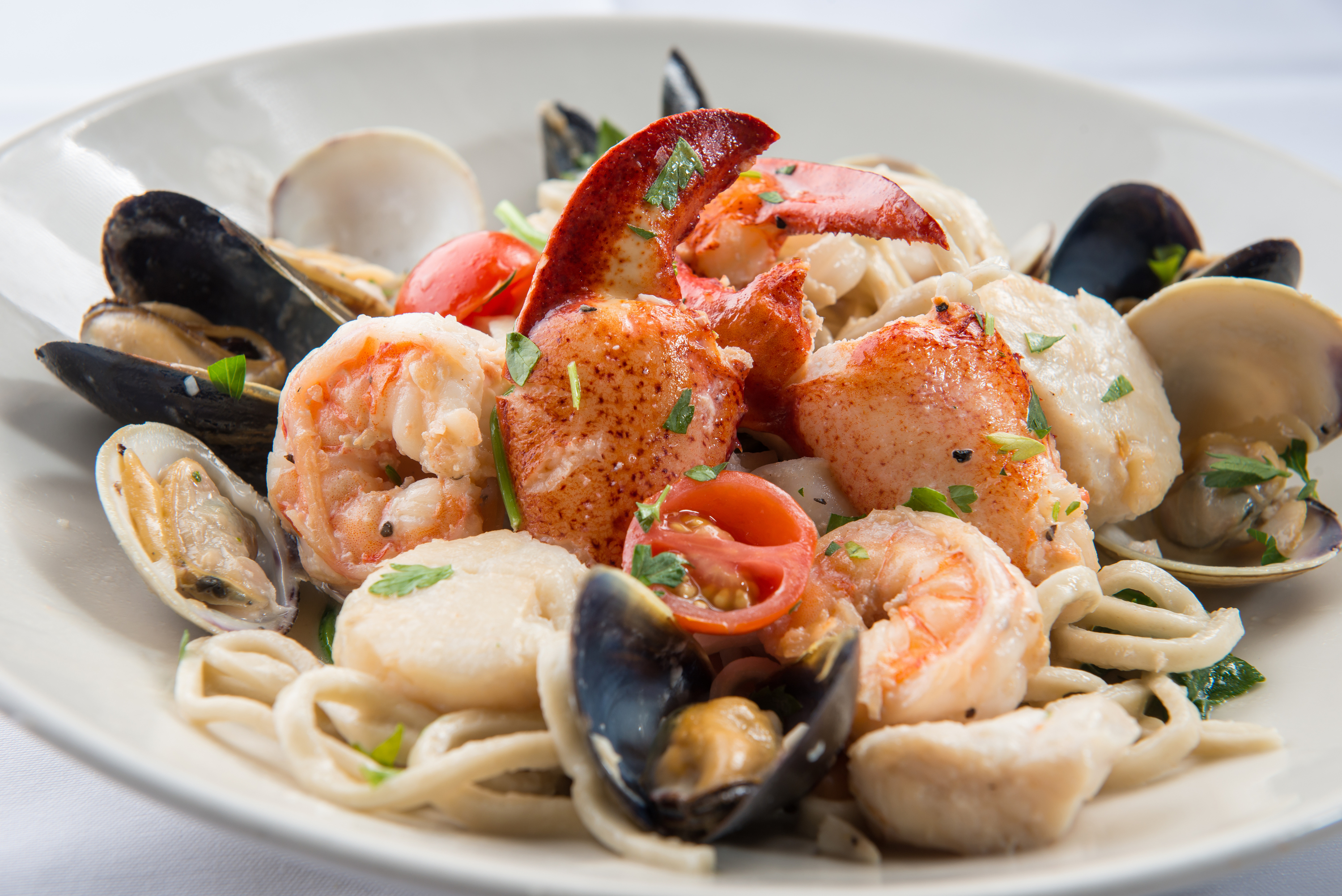Bowl of pasta with seafood on top