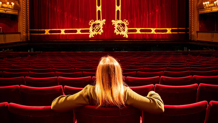 Woman in a theatre