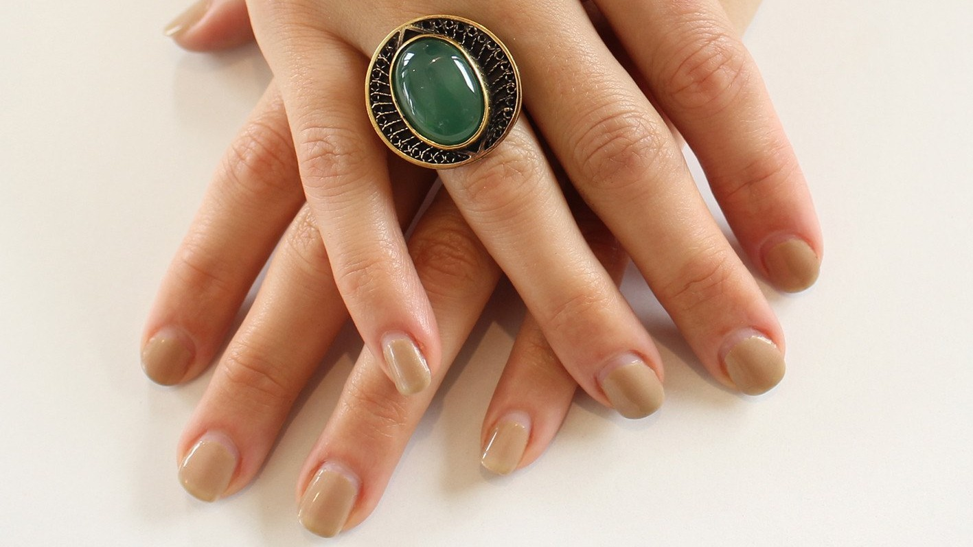 Hands with a green ring