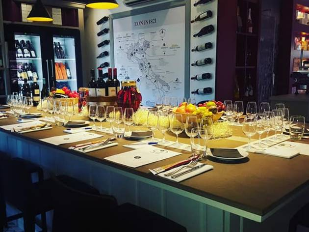 A table with wine glasses and bottles