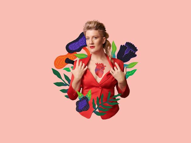 Virginia Gay pulls open a red blazer she's wearing to reveal an illustration of a human heart on her chest. Flower illustrations are overlaid on the photo