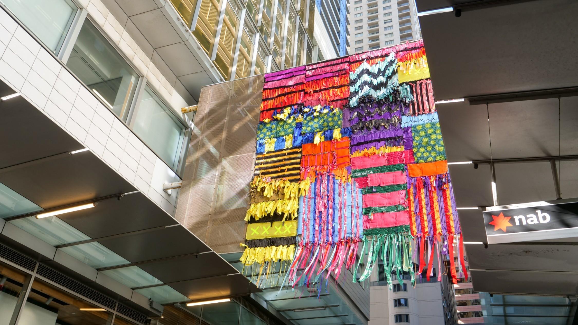 'Weaving Thru the World', at World Square