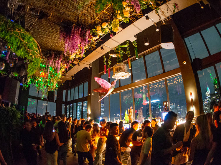 This new secret garden-inspired rooftop is the highest immersive club with a pool in NYC
