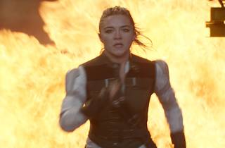 Florence Pugh as Yelena Belova, running from an explosion