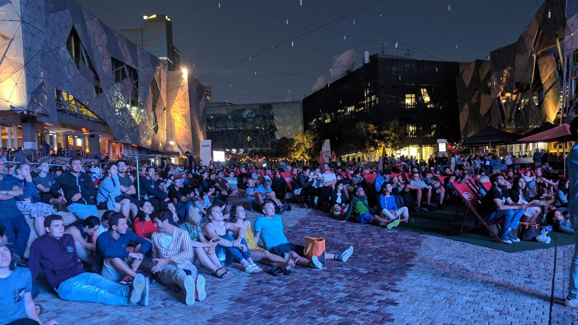 People watching a movie in Fed Square