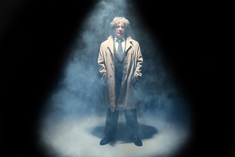 The senior man as detective or boss of mafia on gray studio back