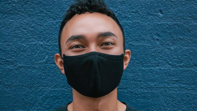 Man wearing mask smiling