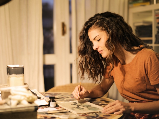 A woman painting at home.