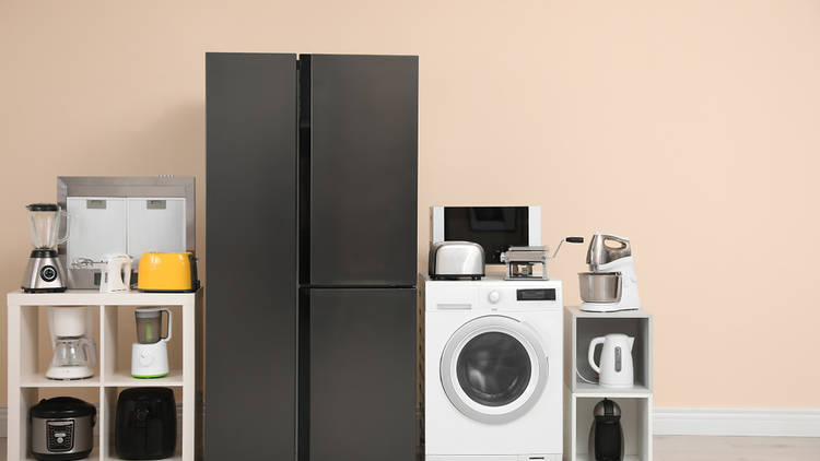 A range of appliances up against a beige wall