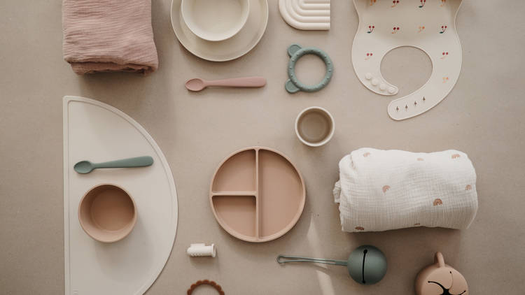 A flatlay of pastel-coloured baby products from Metro Baby