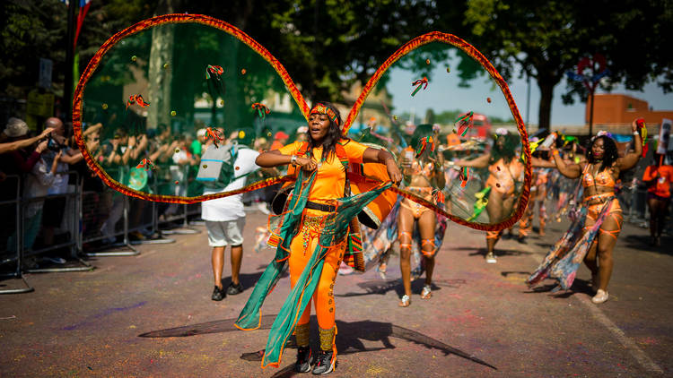A dancer performs at Nottinghill Carnival
