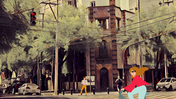 Calle Petén en la Narvarte con ilustración de mujer en bicicleta