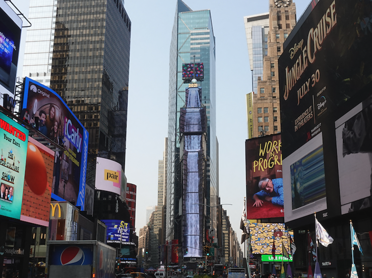 Watch a 350-foot virtual waterfall cascade down One Times Square
