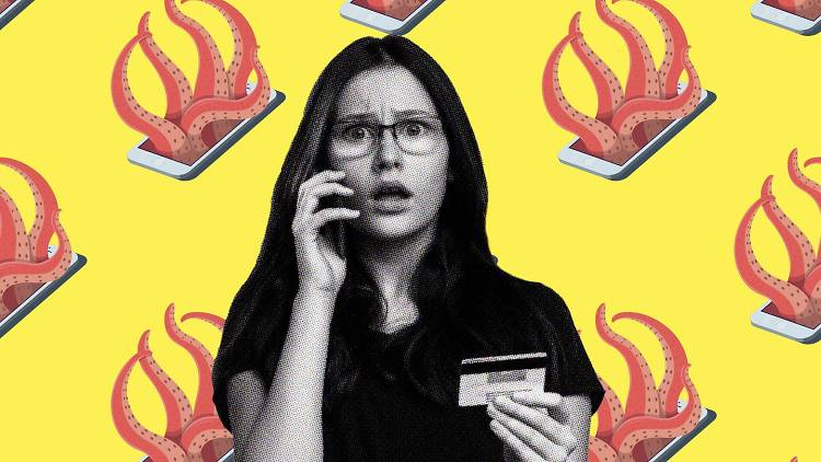 Shocked woman on phone with credit card in hand