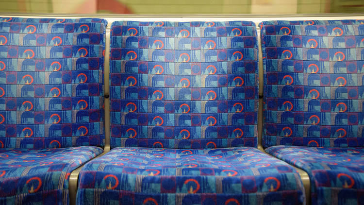 Blue seats on the Central line, London, UK.