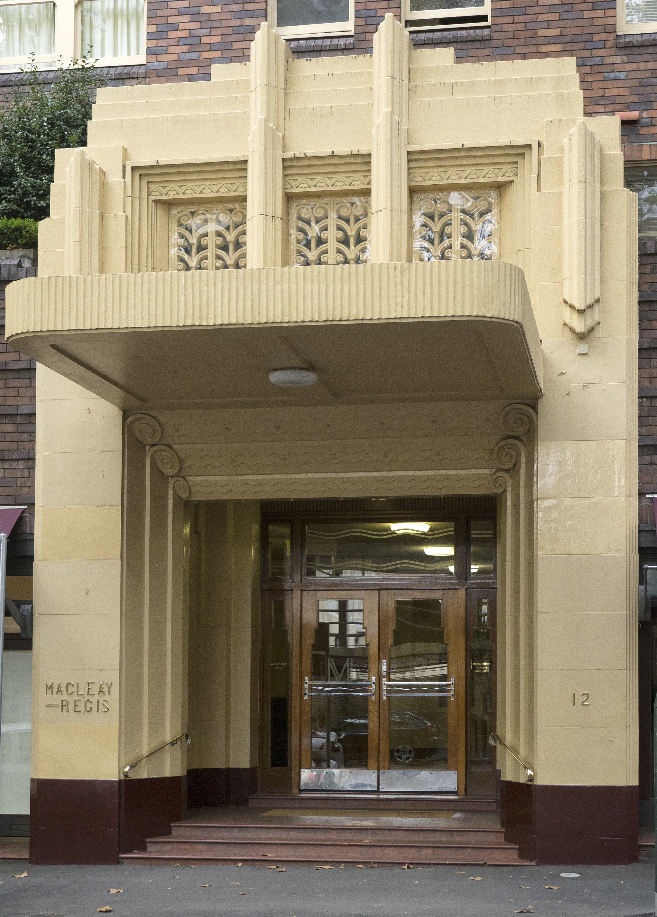 The grand entrance of the Art Deco building the Macleay Regis in Potts Point