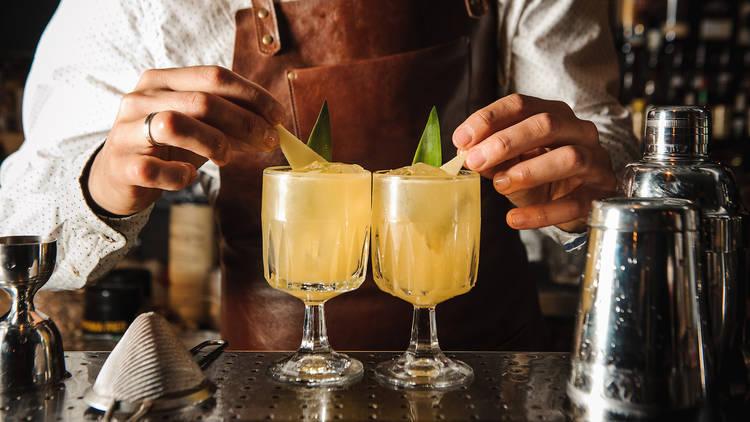 Bartender garnishing cocktails