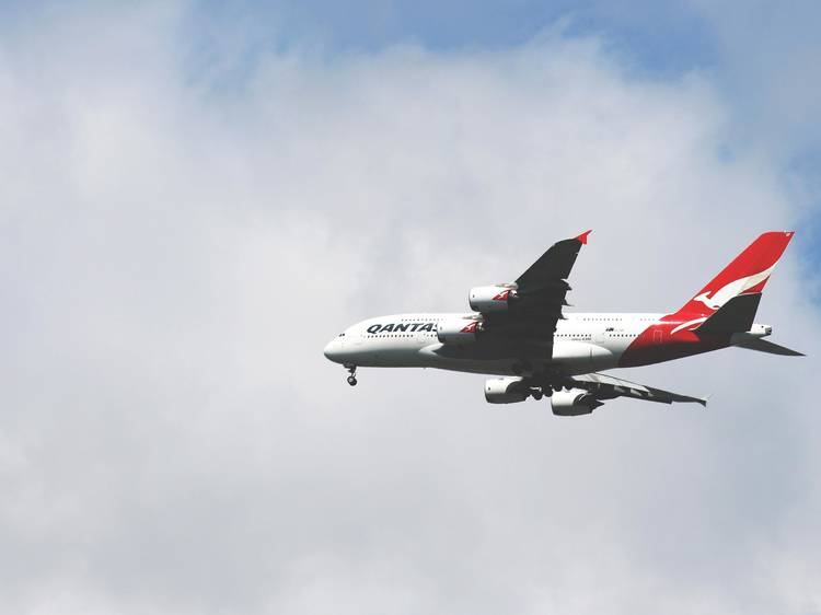 Qantas plans to resume international flights from December