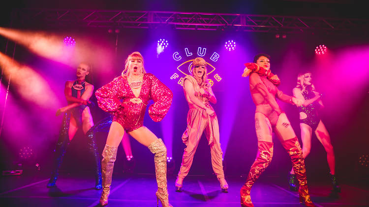 Yummy Deluxe performers on a brightly lit stage