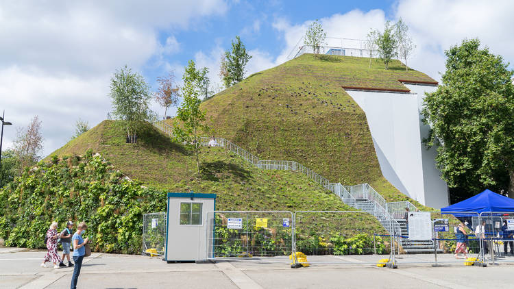 An artificial grassy hill on a sunny day