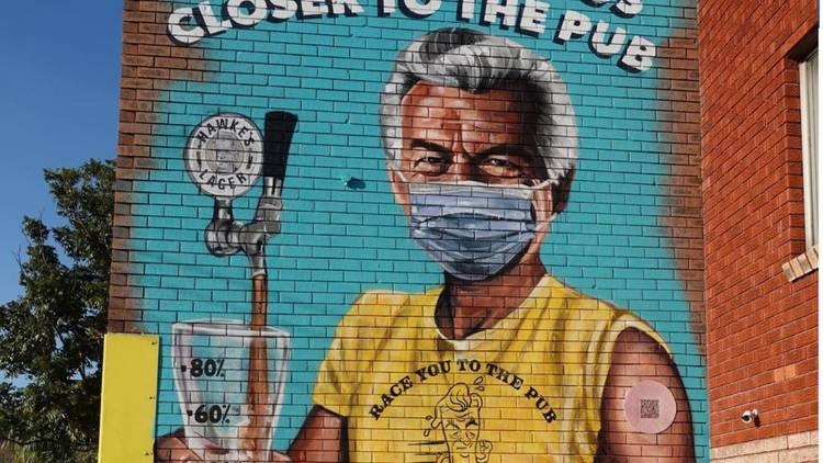 A mural depicting a freshly jabbed Bob Hawke pouring a pint by Scott Marsh, on the side of Marrickville brewery Hawke's Brewing Co.