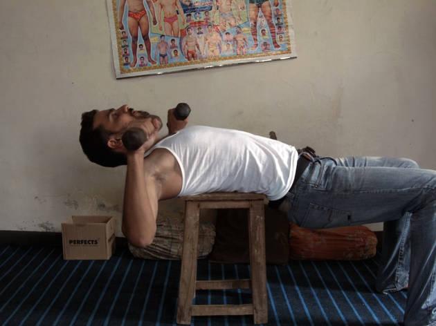 Bani Abidi, man lifting weights