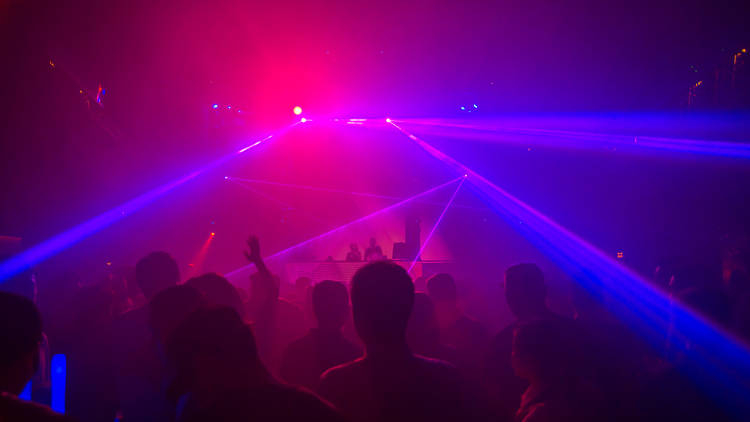Inside a smoky club with lasers