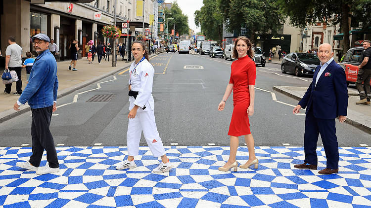 A blue and white zebra crossing in Kensington