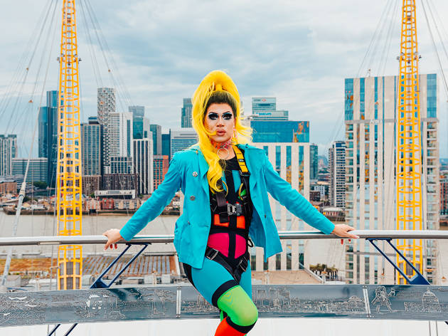 Drag queen Herr stands on the roof of the O2 in front of the London skyline