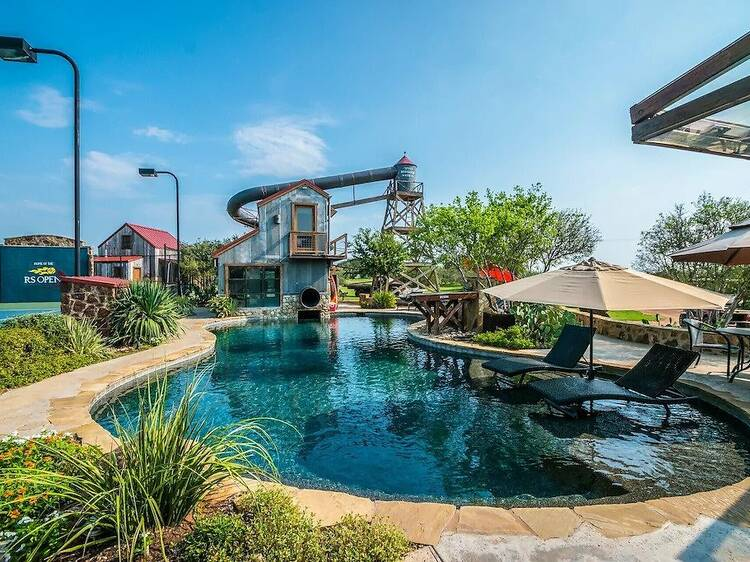 You can rent a holiday home with its own gigantic waterslide