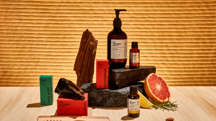 Several hair products from The Groomed Man Co including oils and shampoos.