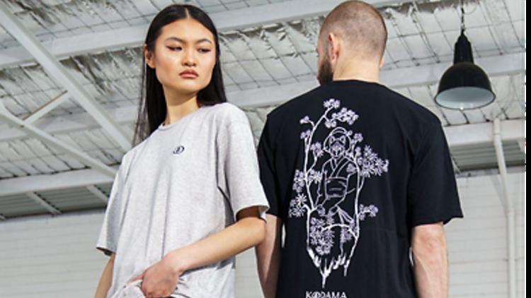 A woman and a man wearing shirts by Kodama Apparel.
