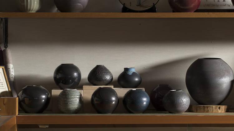 Ceramic pots on shelves
