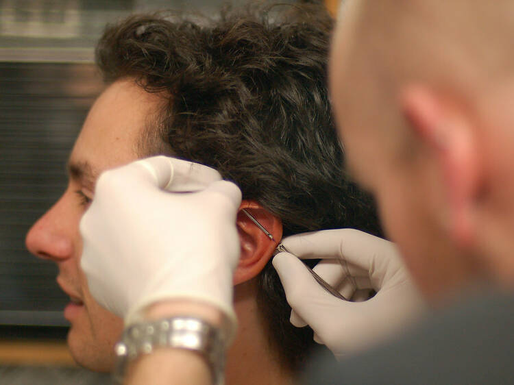Get some holes poked at these piercing studios