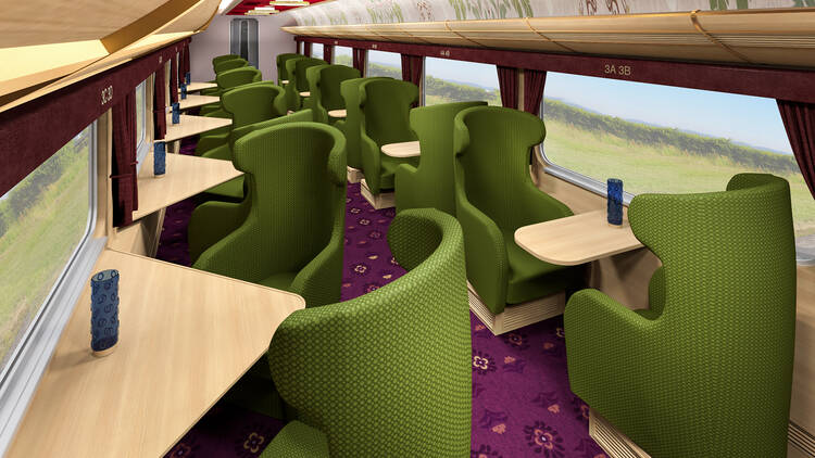 An artist's impression of a train interior, with green lounge seats facing large picture windows, and purple carpet