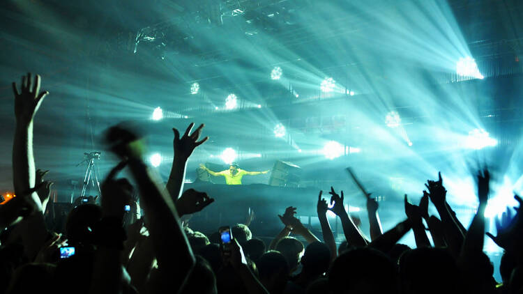 A dj performing at a disco rave