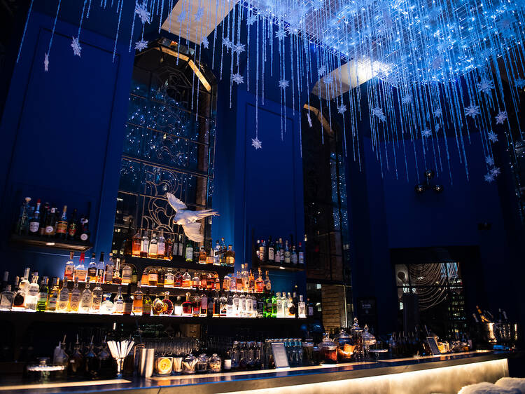 Cozy up with classic cocktails in a snowglobe in the sky