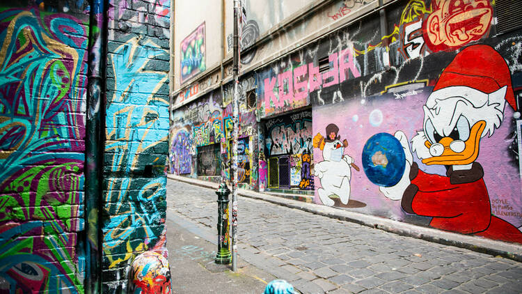 A Melbourne laneway covered in street art.