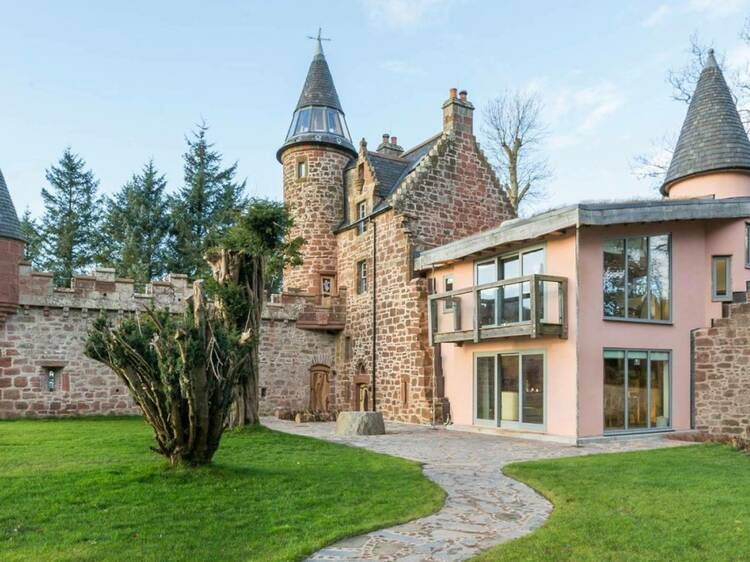 You and your pals could book out this entire pink castle in Scotland