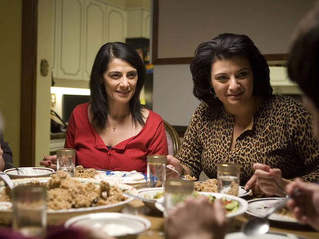 Muna and Raghda looking at Fadi (off-screen).jpg