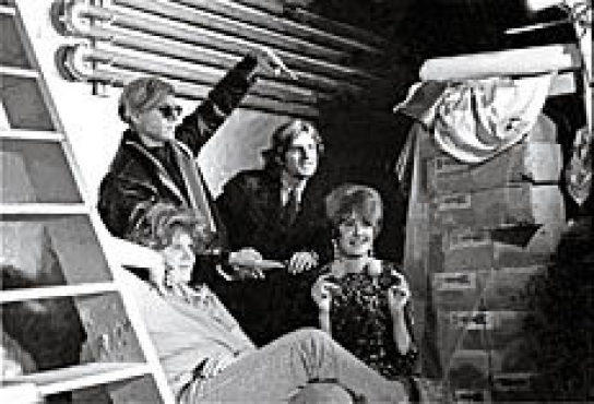 DANDY WARHOL The artist poses with his posse at the Factory in 1967.
